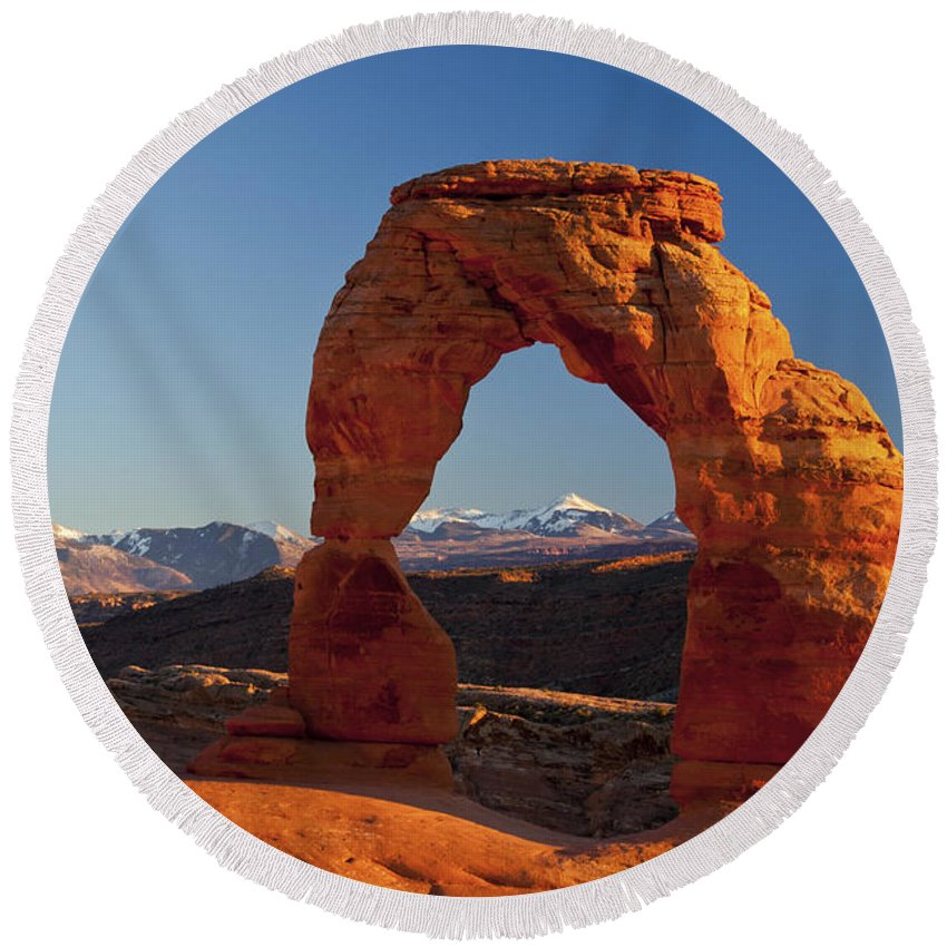 Delicate Arch Round Beach Towel featuring the photograph Sunset At Delicate Arch by Bob Phillips