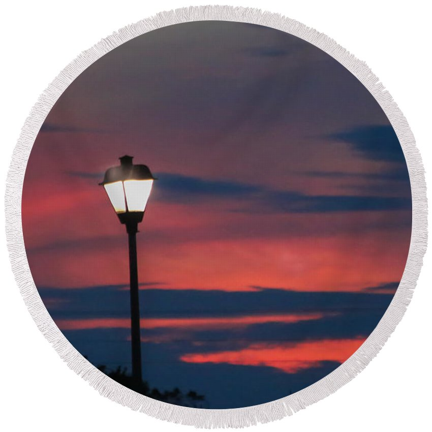 Sunset Round Beach Towel featuring the photograph Sunset Streetlight by Paula OMalley
