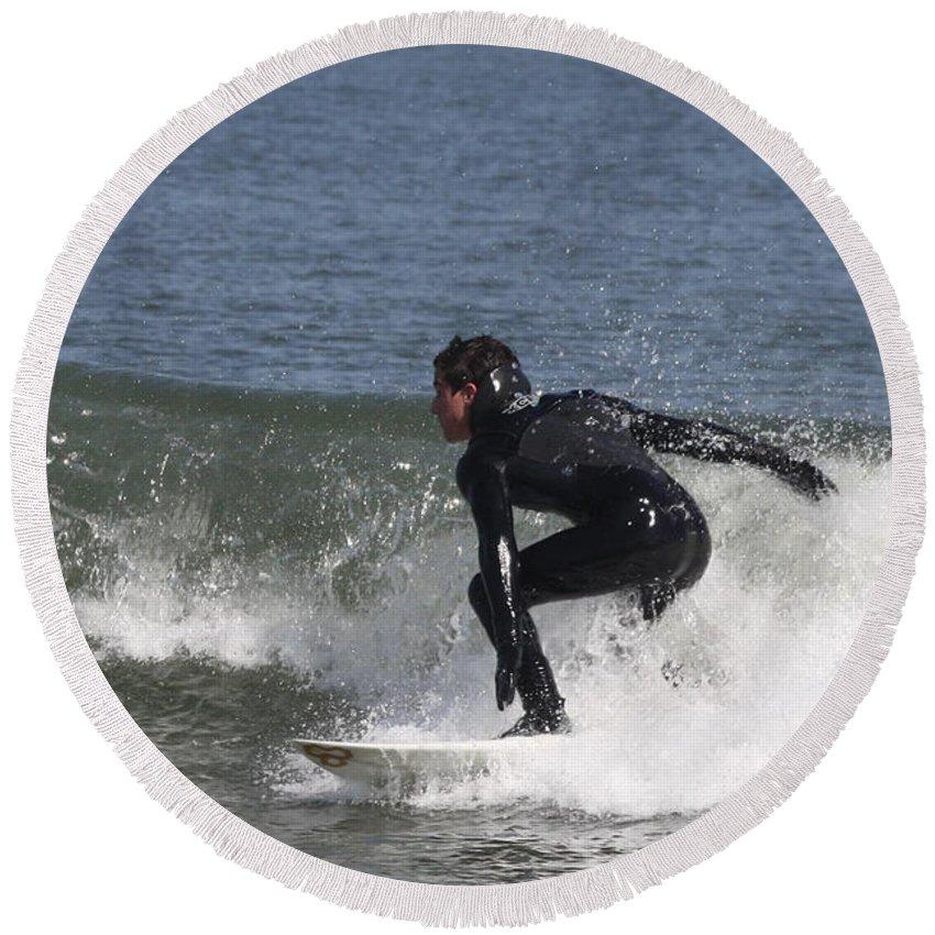 Surfer Hitting The Curl Round Beach Towel featuring the photograph Surfer Hitting The Curl by John Telfer