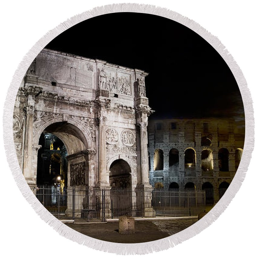 Rome Round Beach Towel featuring the photograph The Arch Of Constantine And The Colosseum At Night by Weston Westmoreland