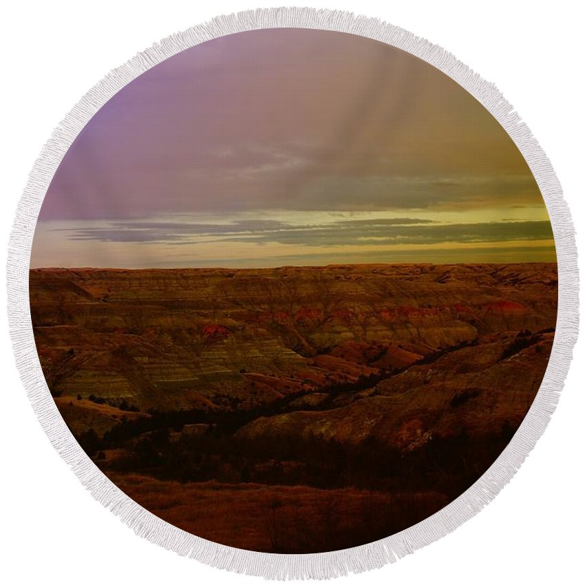 Badlands Round Beach Towel featuring the photograph The Badlands by Jeff Swan