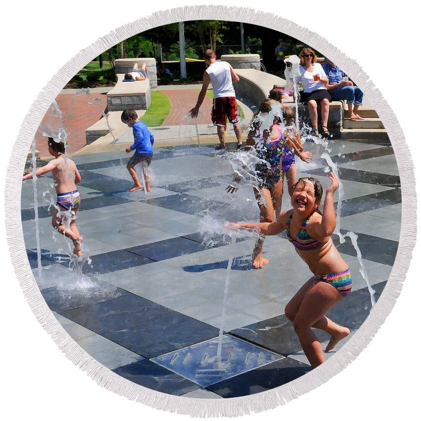 Child Playing In Water Fountain Round Beach Towel featuring the photograph Joyful Young Girl Playing In Fountain by Ginger Wakem