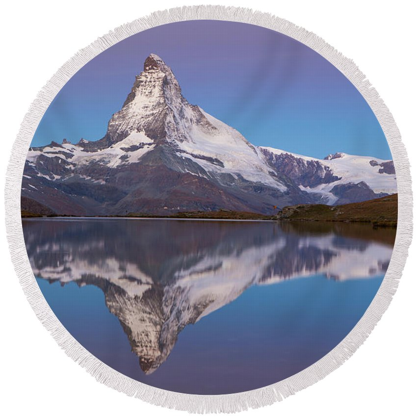 Zermatt Round Beach Towel featuring the photograph The Famous Matterhorn Is Reflected by Menno Boermans