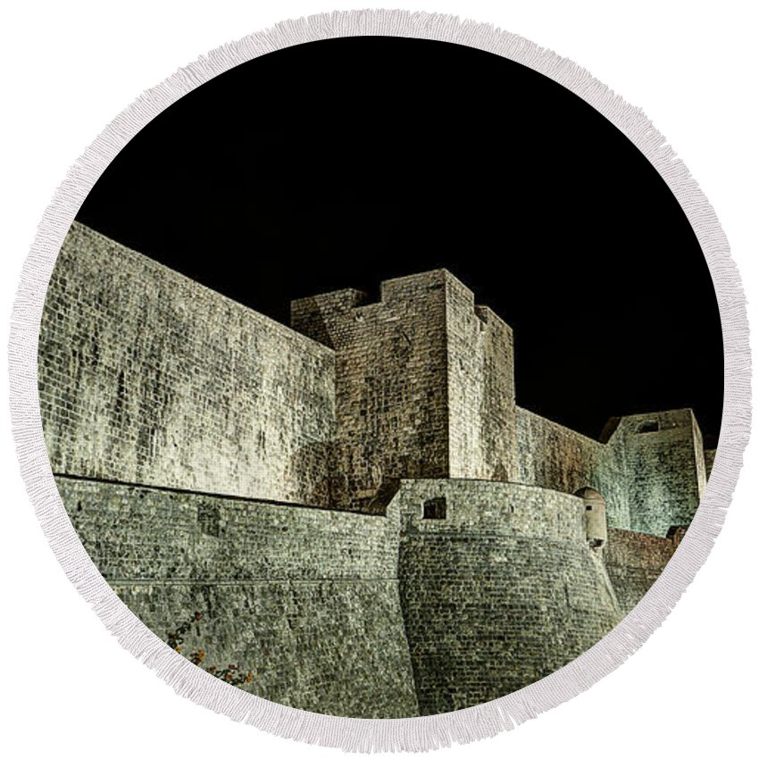 Ramparts Round Beach Towel featuring the photograph The Landside Walls Of Dubrovnik At Night No1 by Weston Westmoreland