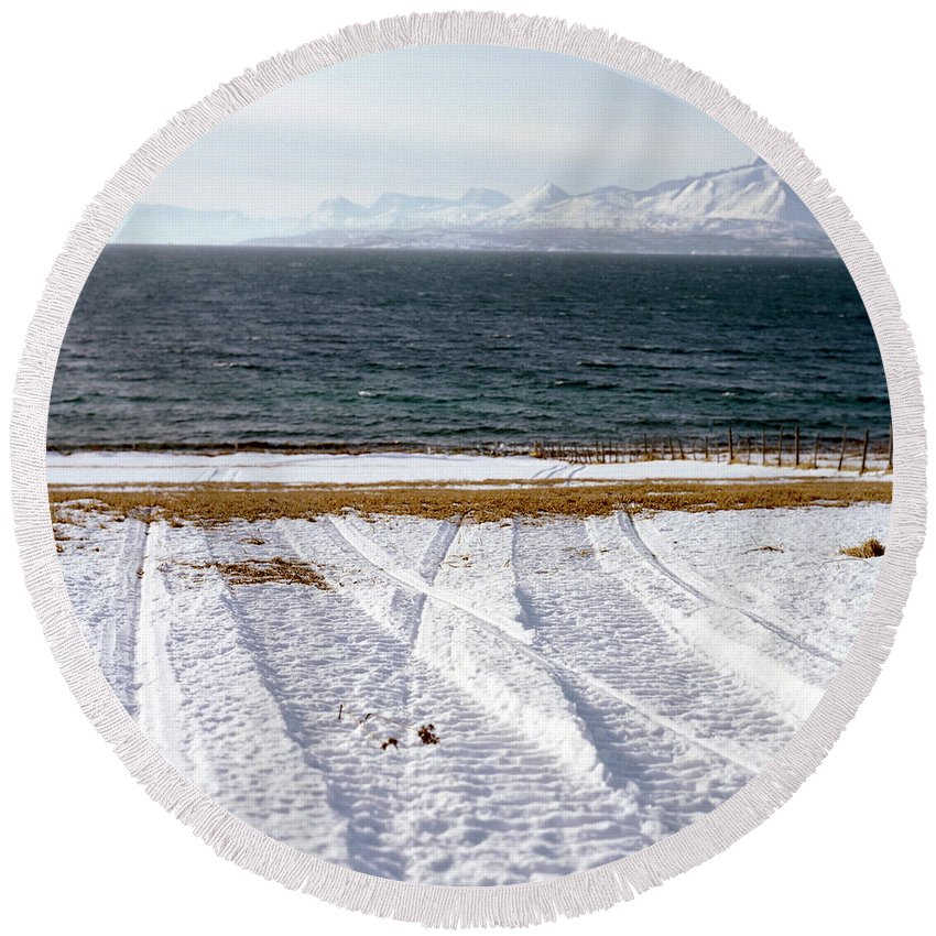 Coast Round Beach Towel featuring the photograph The Lyngen Alps And Snowmobile Tracks by Kari Medig