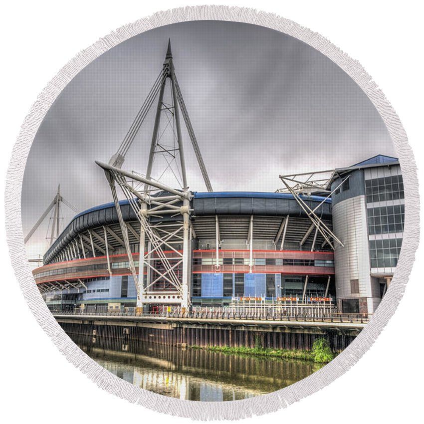 The Millennium Stadium Round Beach Towel featuring the photograph The Millennium Stadium With Flag by Steve Purnell