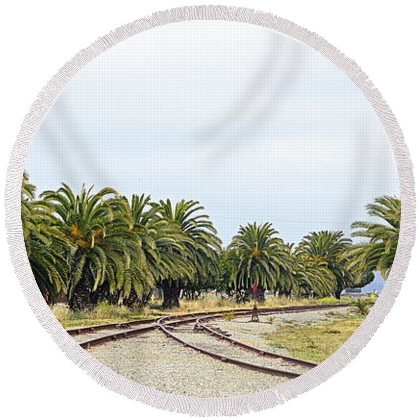 Scenic Round Beach Towel featuring the photograph The Palms By The Tracks by AJ Schibig