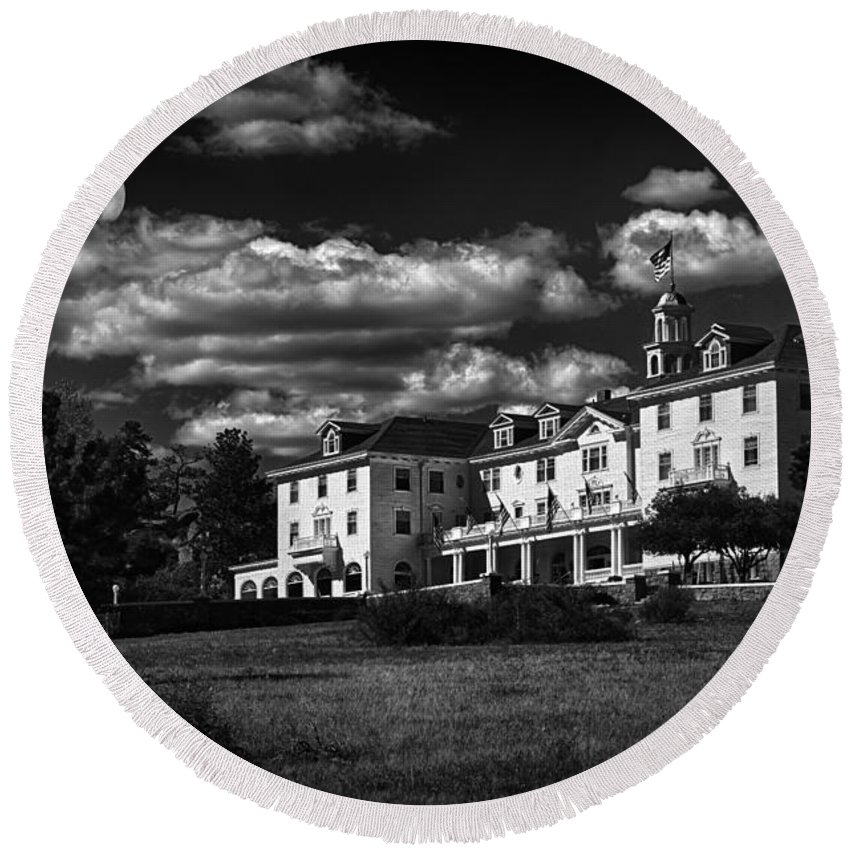 The Stanley Hotel Round Beach Towel featuring the photograph The Stanley Hotel by Priscilla Burgers
