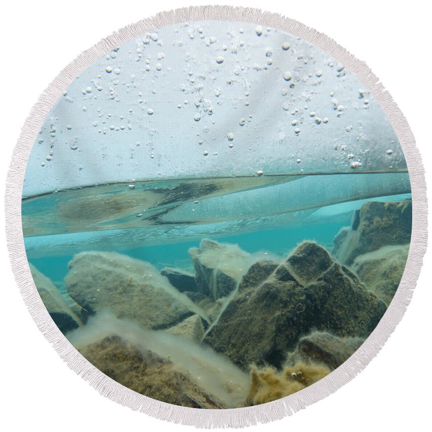 Above Round Beach Towel featuring the photograph Thick Ice Sheet Underwater Over Rocky Lake Bottom by Stephan Pietzko
