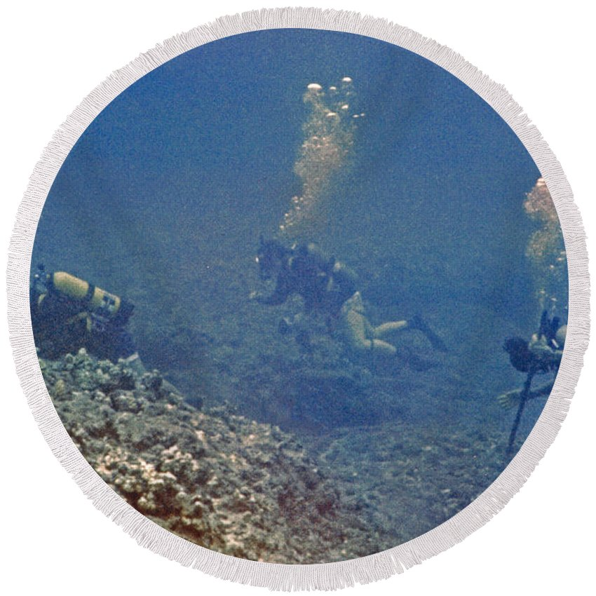Three Divers Round Beach Towel featuring the photograph Three Divers In Hawaii by Bill Owen