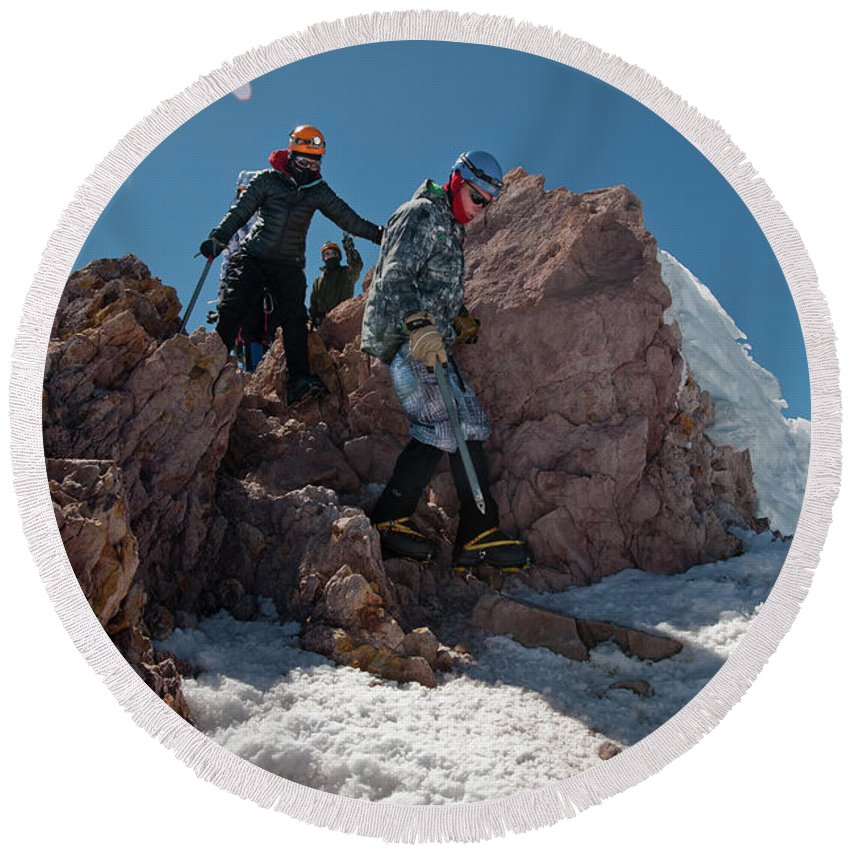 Young Man Round Beach Towel featuring the photograph Three People Climb Down Rocks by Beth Wald
