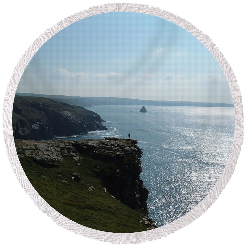 Tintagel Round Beach Towel featuring the photograph Man On The Edge Tintagel by Richard Brookes