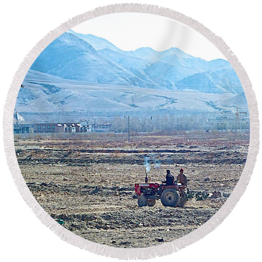 Tractor Used In Farming Along The Road To Shigatse Round Beach Towel featuring the photograph Tractor Used In Farming Along The Road To Shigatse-tibet by Ruth Hager