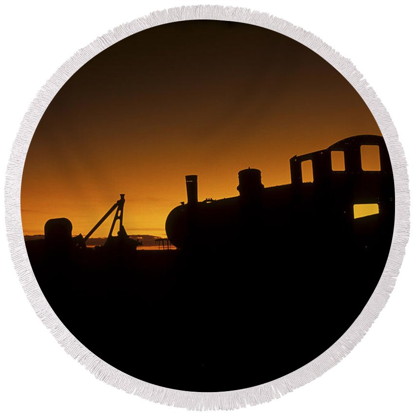 Train Round Beach Towel featuring the photograph Uyuni Train Cemetery Sunset Bolivia by James Brunker