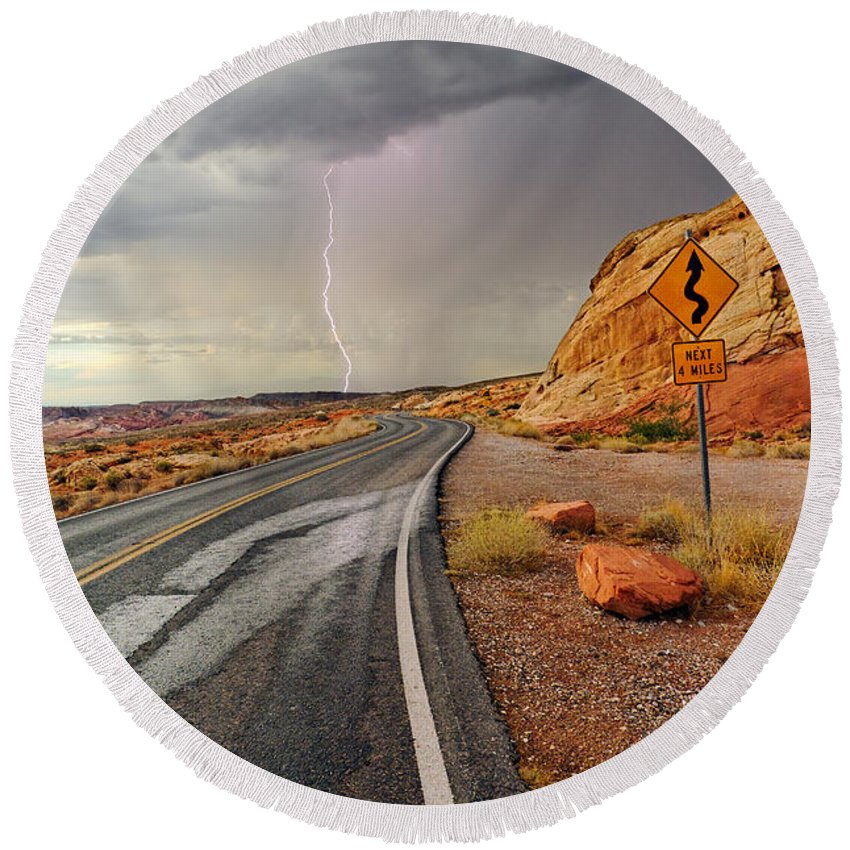 Lightning Round Beach Towel featuring the photograph Uncertainty - Lightning Striking During A Storm In The Valley Of Fire State Park In Nevada. by Jamie Pham