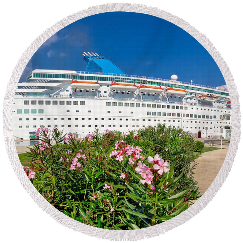 Cruiser Round Beach Towel featuring the photograph Unnamed Cruiser Docked On Waterfront by Brch Photography