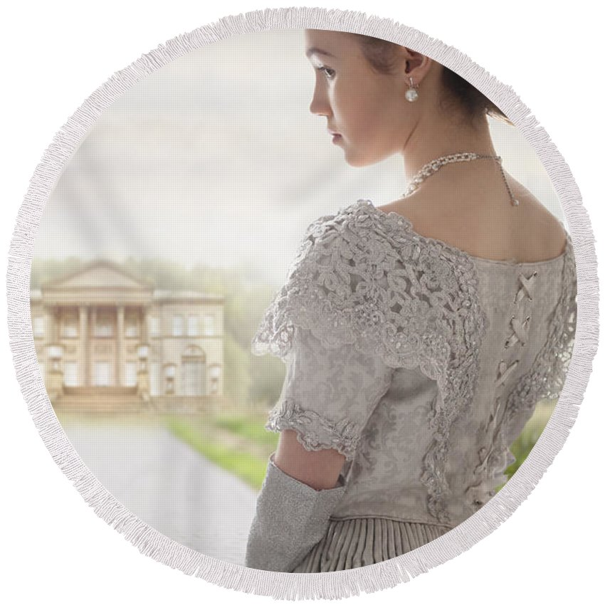 Victorian Round Beach Towel featuring the photograph Victorian Woman Approaching A Country Manor House by Lee Avison