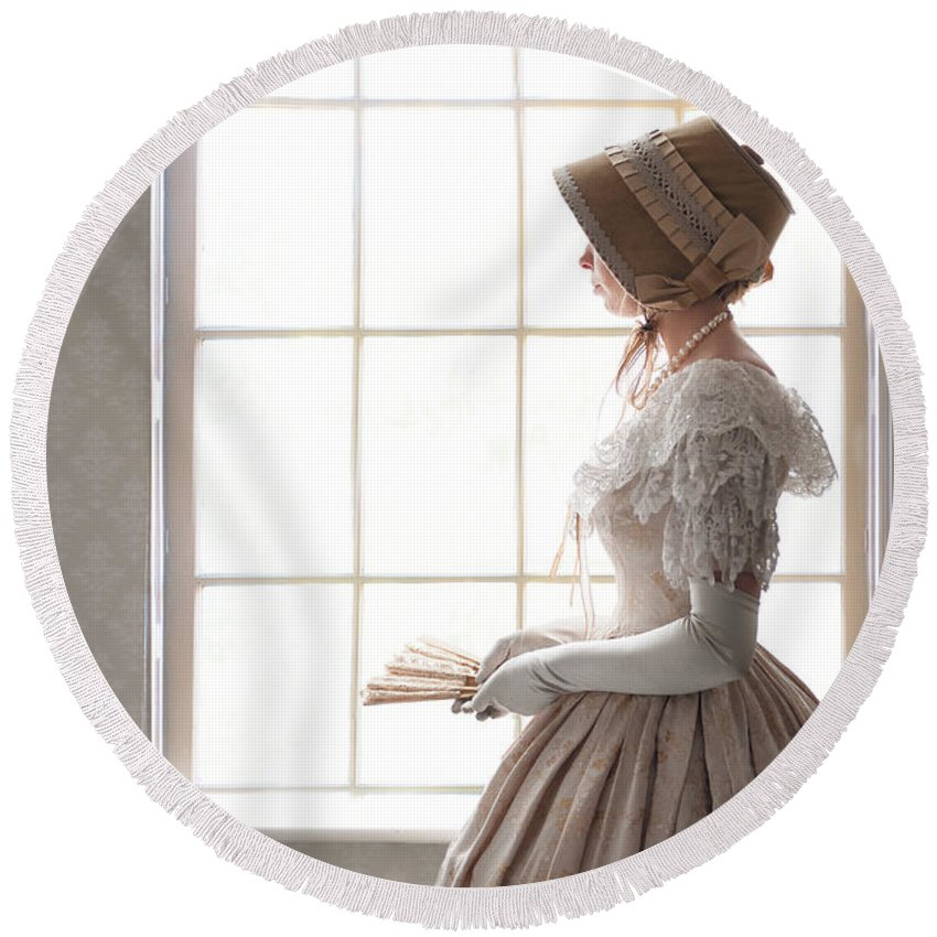 Victorian Round Beach Towel featuring the photograph Victorian Woman In Profile At A Window by Lee Avison
