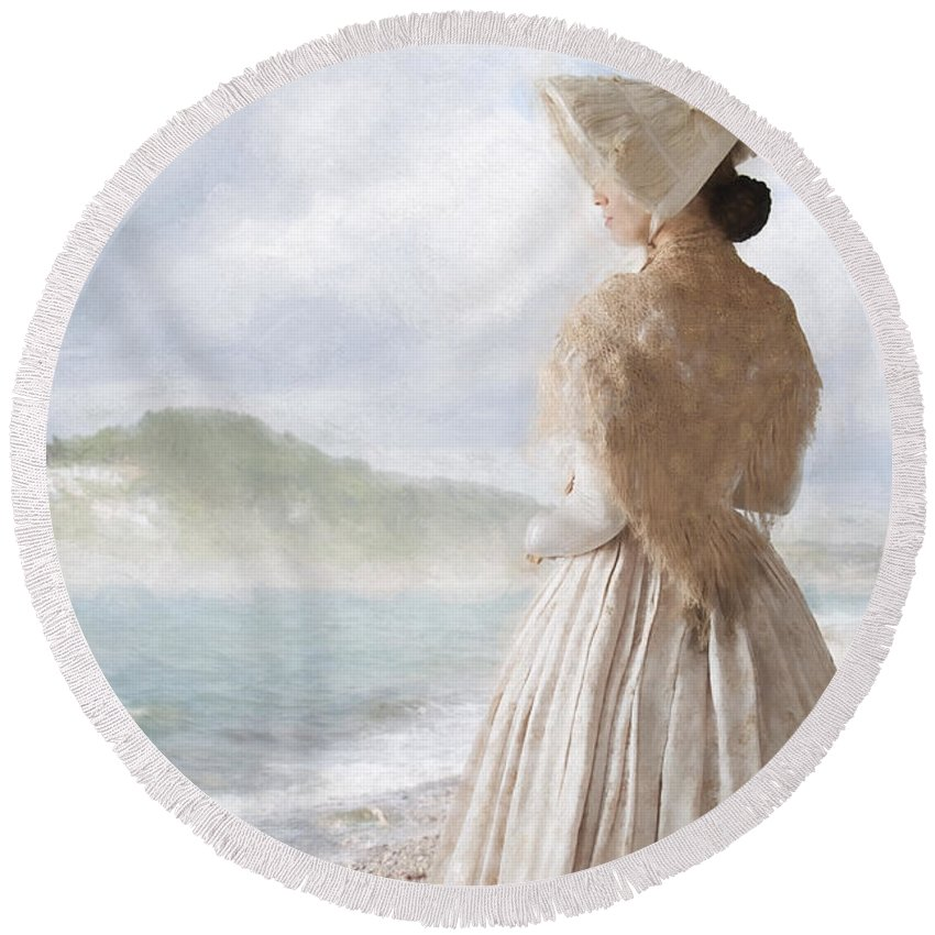 Victorian Round Beach Towel featuring the photograph Victorian Woman On The Beach Looking Out To Sea by Lee Avison