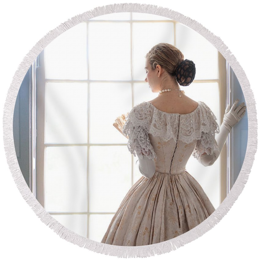 Victorian Round Beach Towel featuring the photograph Victorian Woman Standing At The Window by Lee Avison