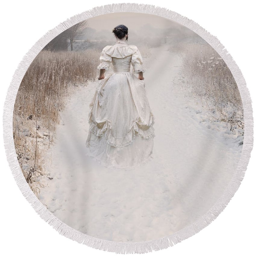 Woman Round Beach Towel featuring the photograph Victorian Woman Walking Through A Winter Meadow by Lee Avison