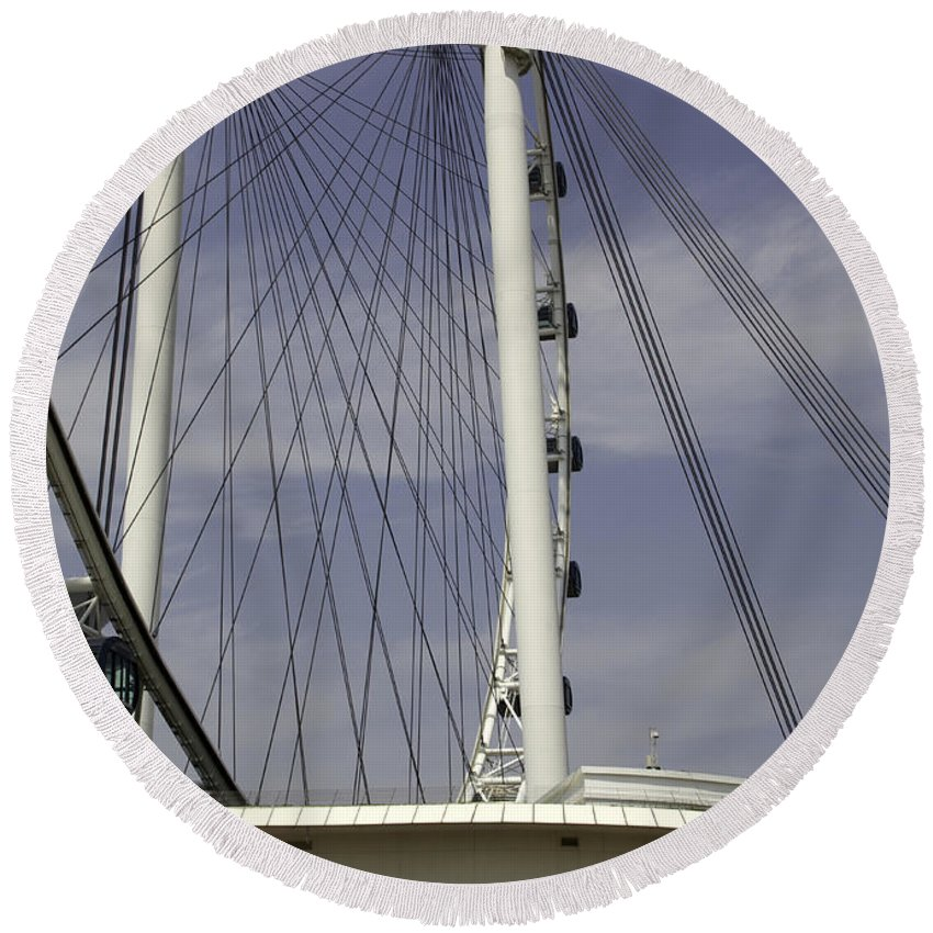 Action Round Beach Towel featuring the photograph View Of Spokes Of The Singapore Flyer Along With The Base Section by Ashish Agarwal