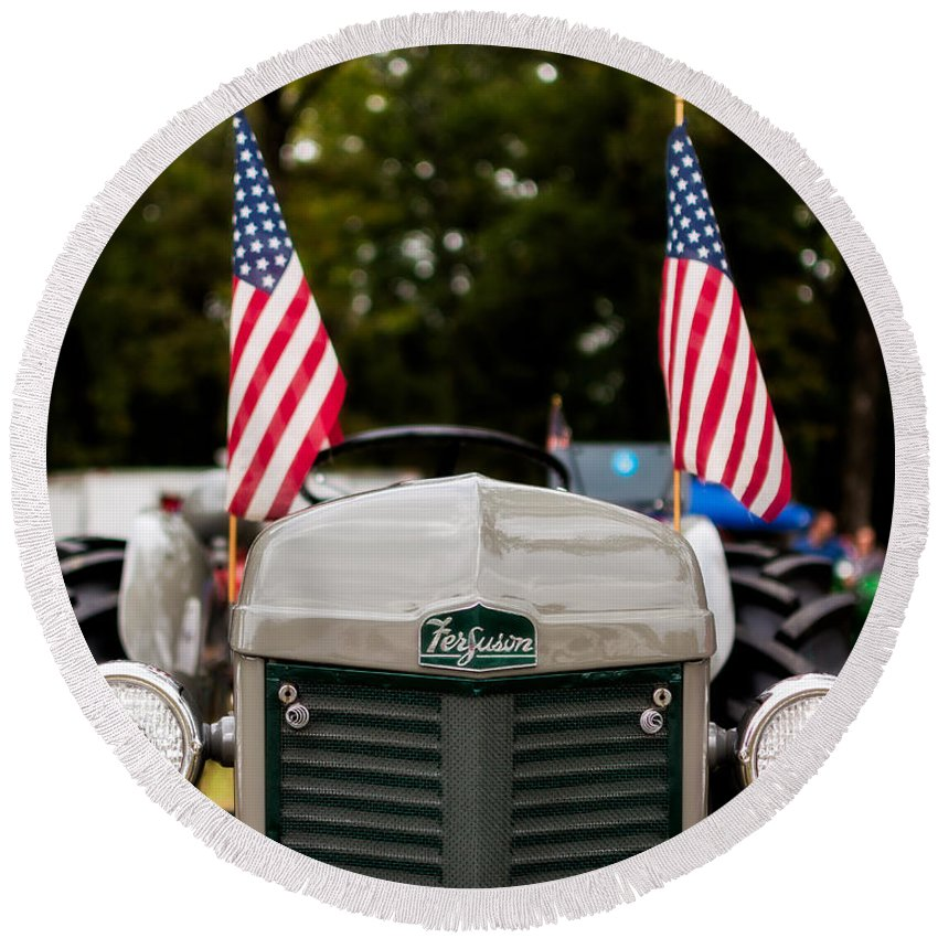 Ferguson Round Beach Towel featuring the photograph Vintage Ferguson Tractor With American Flags by Jon Woodhams