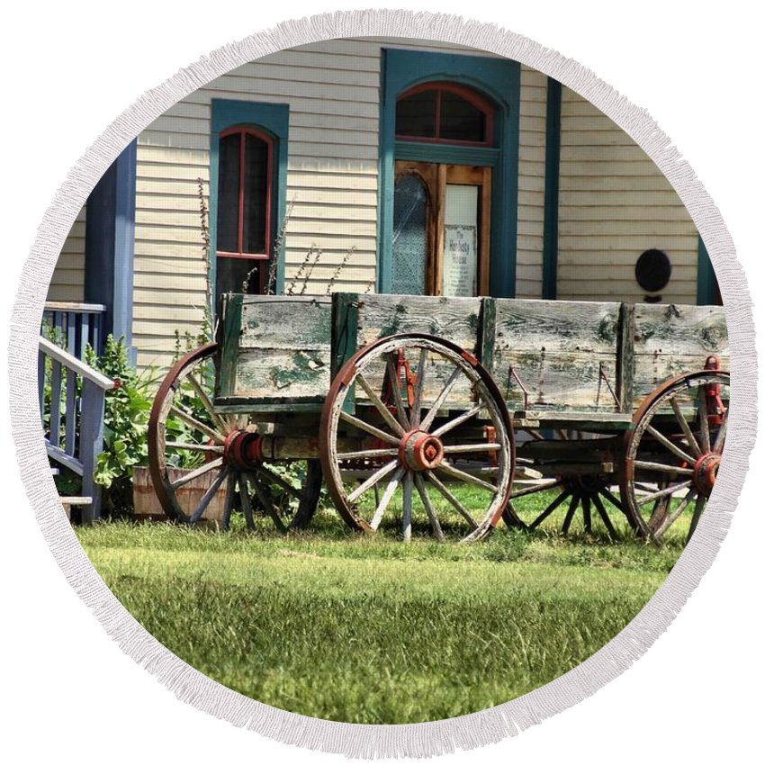 Wagon Wheels Round Beach Towel featuring the photograph Wagon Wheels In Dodge City by Dan Sproul