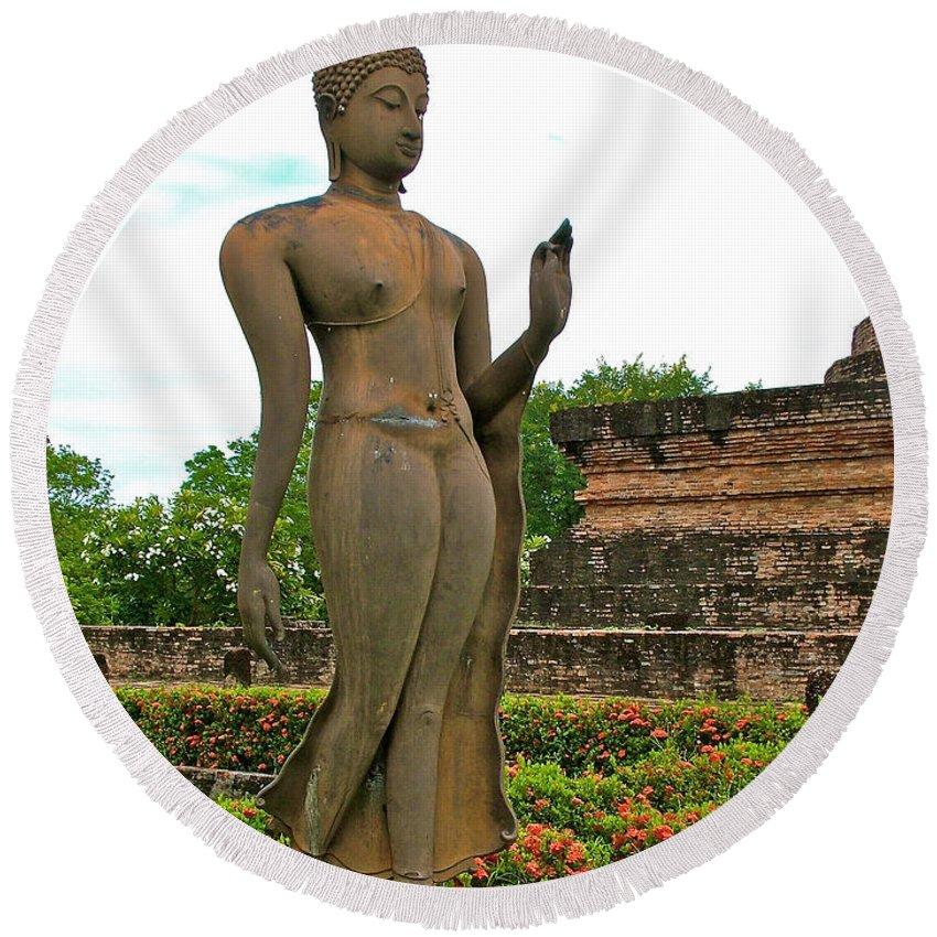 Walking Buddha Image At Wat Sa Si In 13th Century Sukhothai Historical Park Round Beach Towel featuring the photograph Walking Buddha Image In Wat Sa Si In Sukhothai Historical Park-t by Ruth Hager