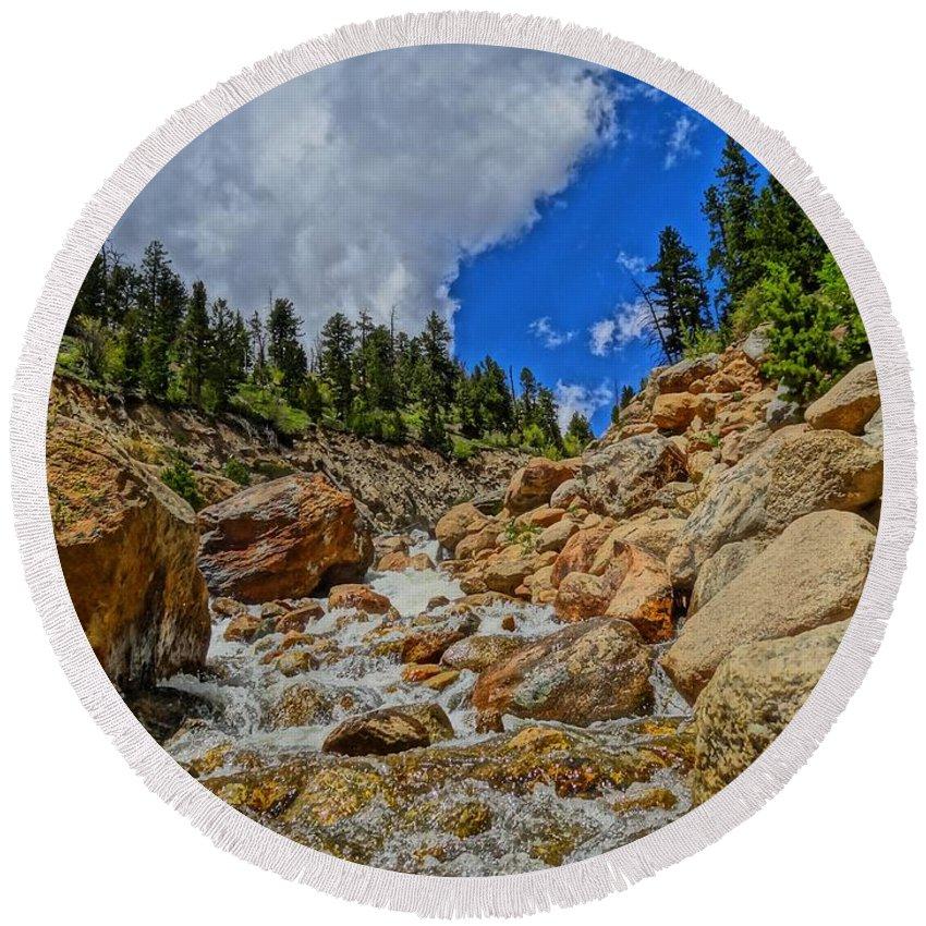 Waterfall In The Rockies Round Beach Towel featuring the photograph Waterfall In The Rockies by Dan Sproul