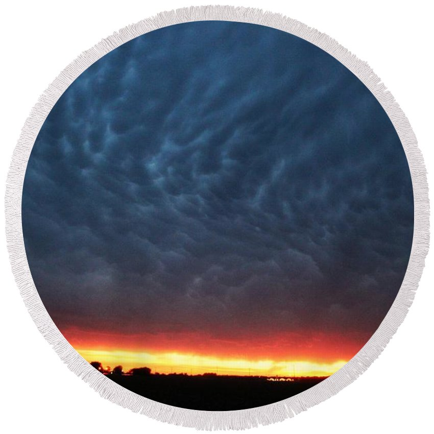 Stormscape Round Beach Towel featuring the photograph Weaking Cells Made For A Perfect Mammatus Sunset by NebraskaSC