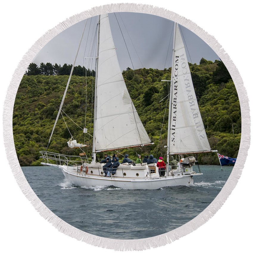 Lake Taupo New Zealand Water Hill Hillside Hills Hillsides Mountain Mountains Snow Landscape Landscapes Waterscape Waterscapes Sailboat Sailboats Boat Boats Sailor Sailors People Person Persons Round Beach Towel featuring the photograph Wet---cold---windy by Bob Phillips