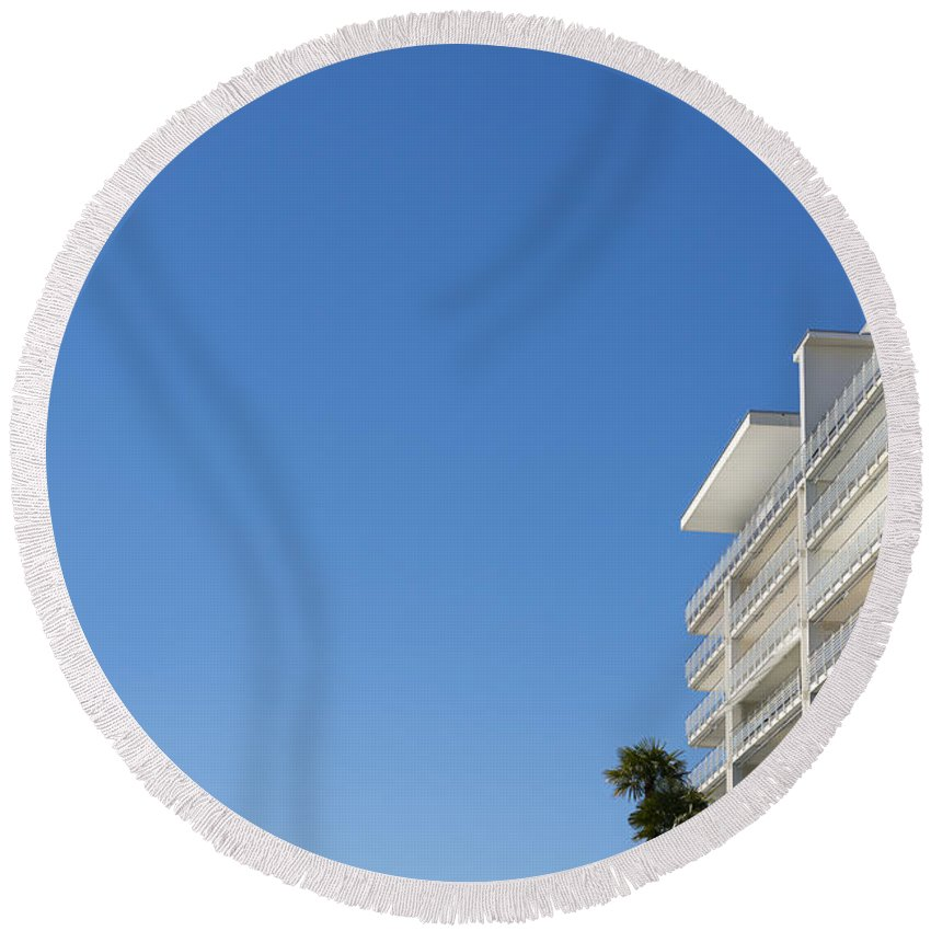 Building Round Beach Towel featuring the photograph White Building And Palm Trees by Mats Silvan