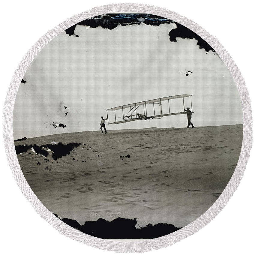 The Wright Brothers Round Beach Towel featuring the photograph The Wright Brothers Wilbur In Motion At Left Holding One End Of Glider by R Muirhead Art