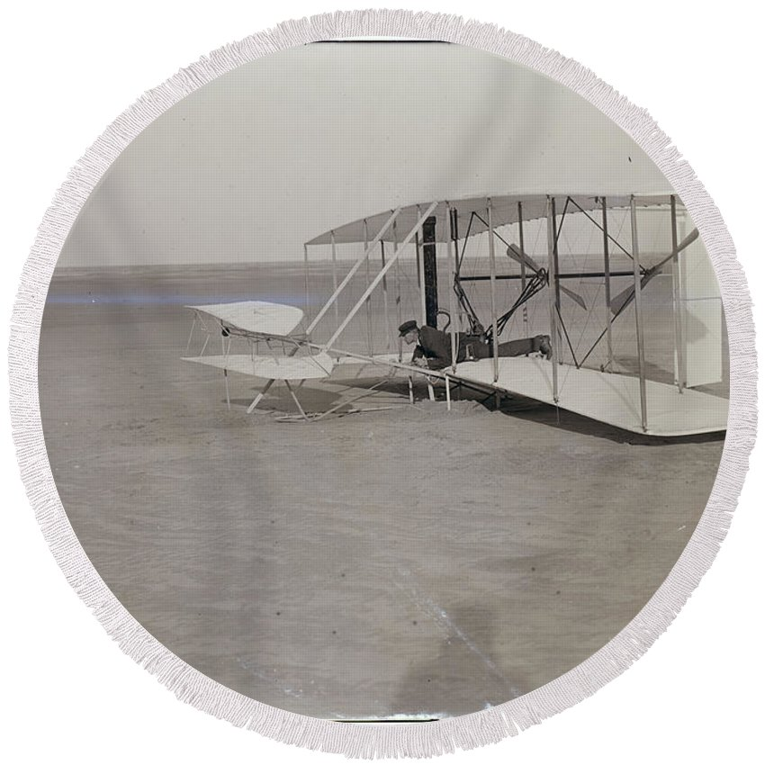 The Wright Brothers Round Beach Towel featuring the photograph The Wright Brothers Wilbur In Prone Position In Damaged Machine by R Muirhead Art