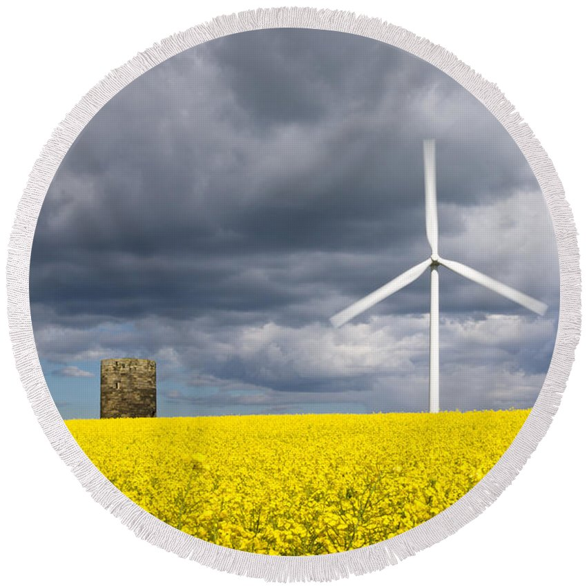 Agriculture Round Beach Towel featuring the photograph Windmill With Motion Blur In Rapeseed Field by David Head
