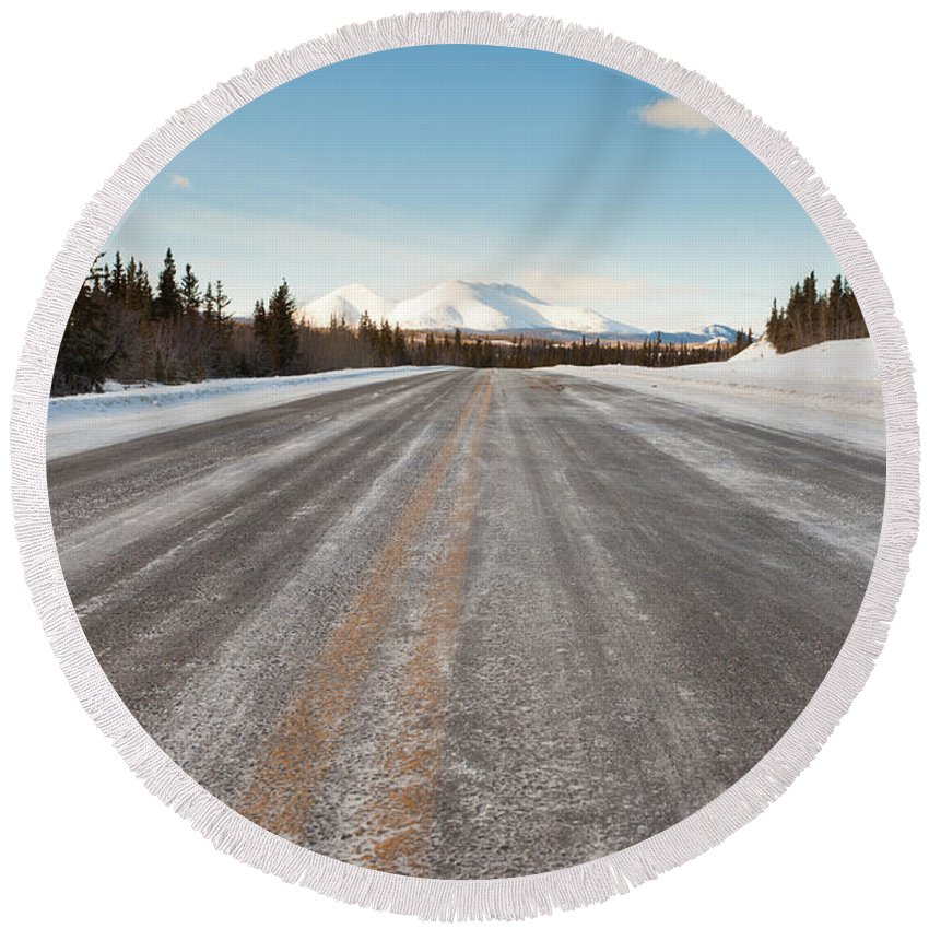 Beautiful Round Beach Towel featuring the photograph Winter On Country Road In Taiga And Snowy Mountain by Stephan Pietzko