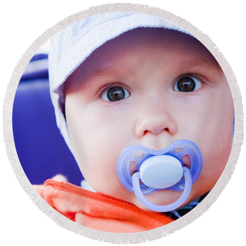Child Round Beach Towel featuring the photograph Young Baby Boy With A Dummy In His Mouth Outdoors by Michal Bednarek