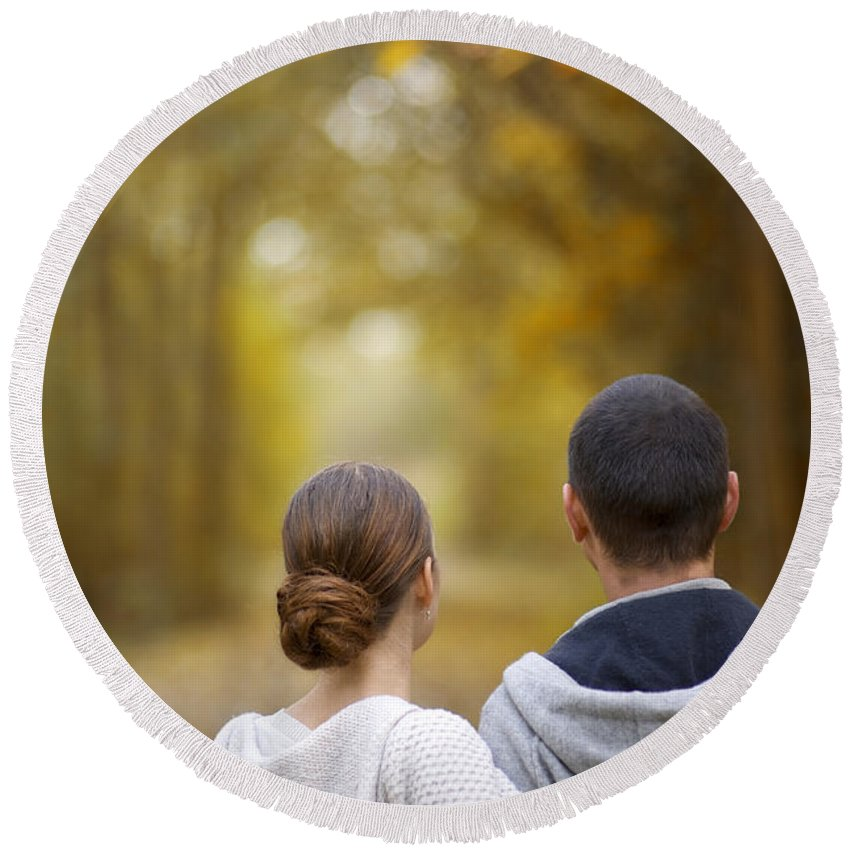 Couple Round Beach Towel featuring the photograph Young Couple Looking Ahead by Lee Avison