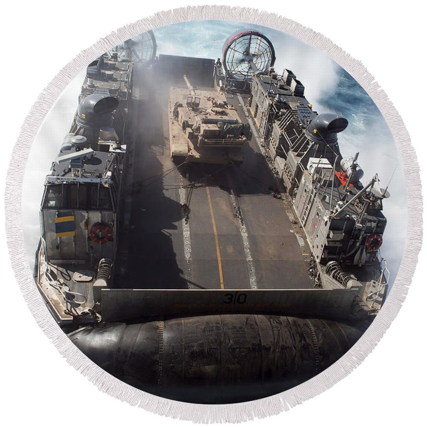Motion Round Beach Towel featuring the photograph A Landing Craft Air Cushion Transits by Stocktrek Images