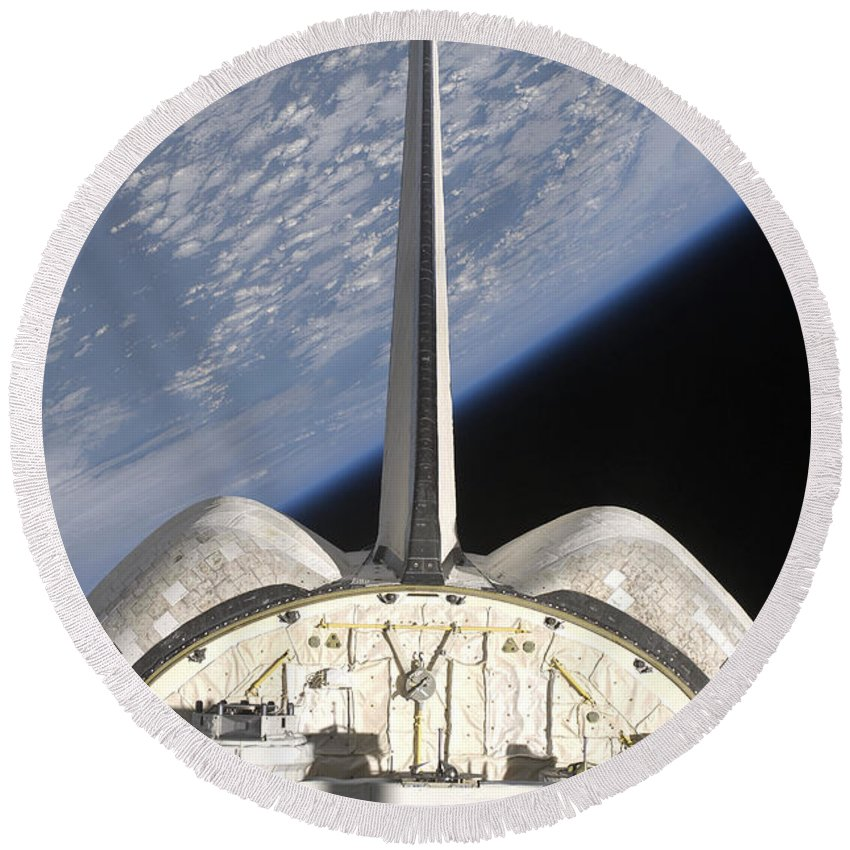 Sts-127 Round Beach Towel featuring the photograph A Partial View Of Space Shuttle by Stocktrek Images