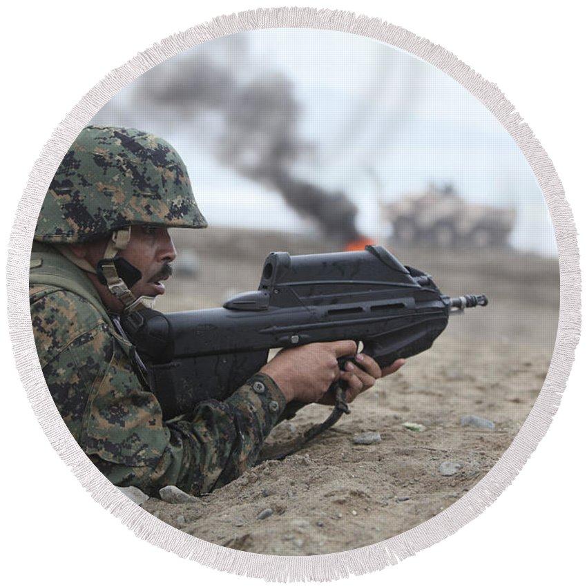 F2000 Round Beach Towel featuring the photograph A Peruvian Marine Assaults A Beach by Stocktrek Images