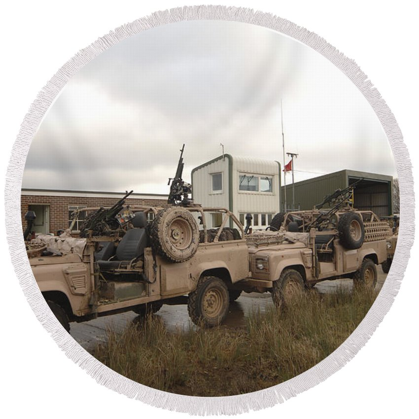 Foreign Military Round Beach Towel featuring the photograph A Pink Panther Land Rover by Andrew Chittock