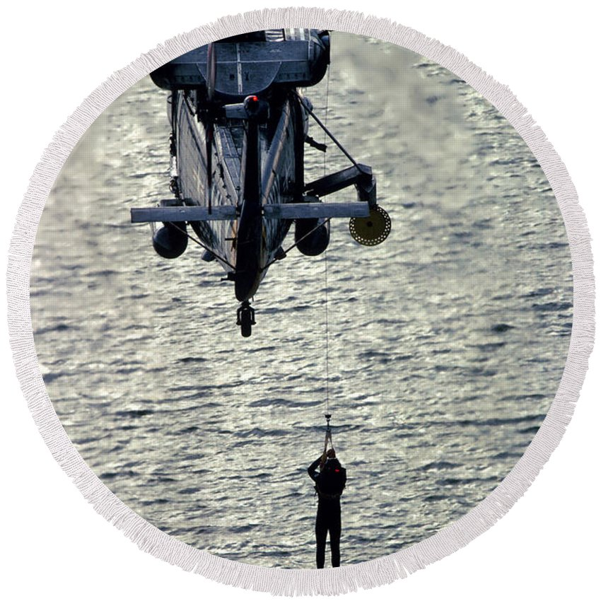 Vertical Round Beach Towel featuring the photograph A Search And Rescue Swimmer Is Hoisted by Stocktrek Images