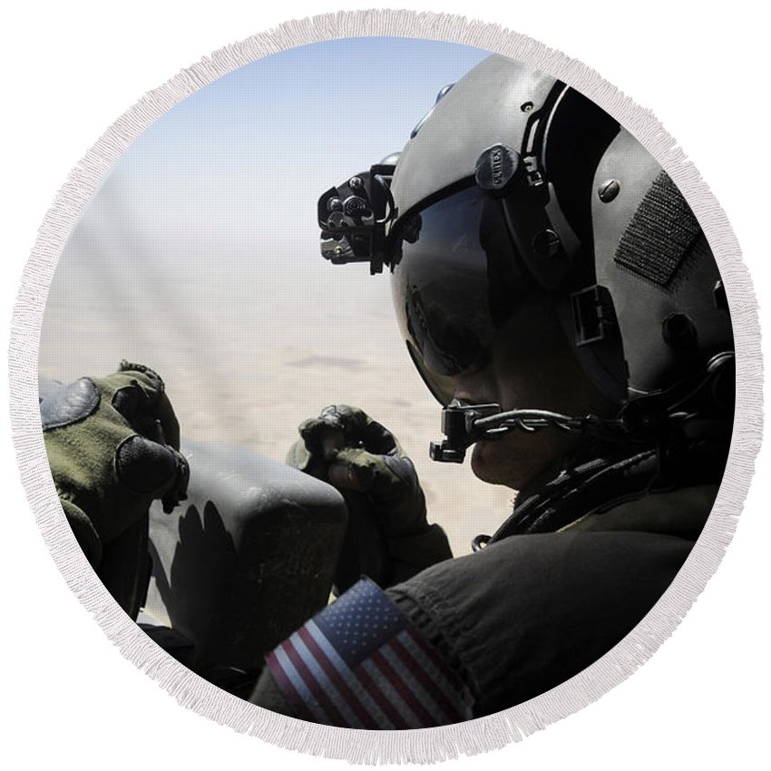 Aerial Gunner Round Beach Towel featuring the photograph A Soldier Provides Security by Stocktrek Images