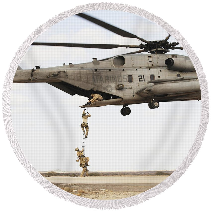 Africom Round Beach Towel featuring the photograph Air Force Pararescuemen Conduct by Stocktrek Images