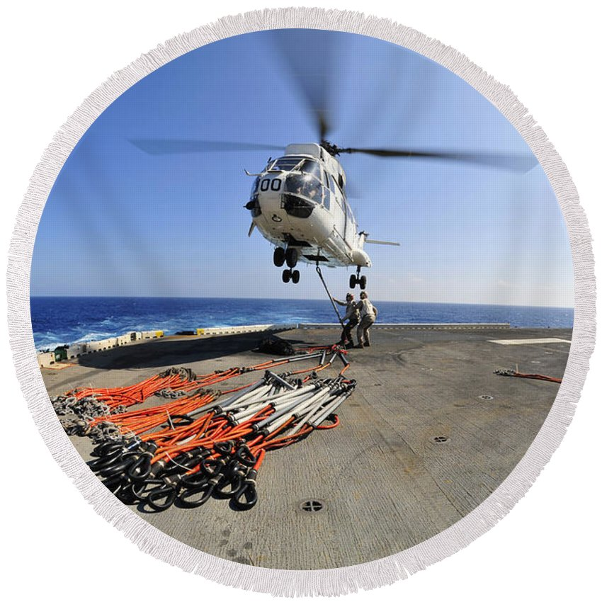 Cable Round Beach Towel featuring the photograph Airmen Attach Pallet Rigs To An Sa-330j by Stocktrek Images