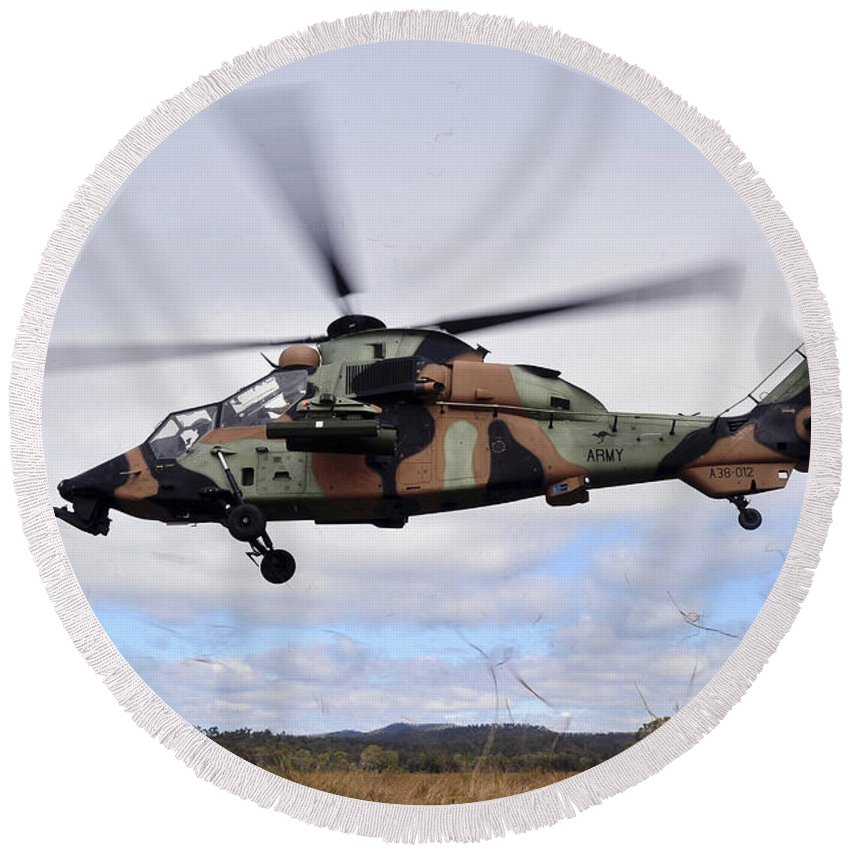 Australian Army Round Beach Towel featuring the photograph An Australian Army Tiger Helicopter by Stocktrek Images
