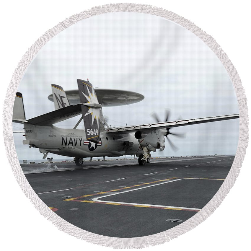 Uss Abraham Lincoln Round Beach Towel featuring the photograph An E-2c Hawkeye Launches Off The Flight by Stocktrek Images