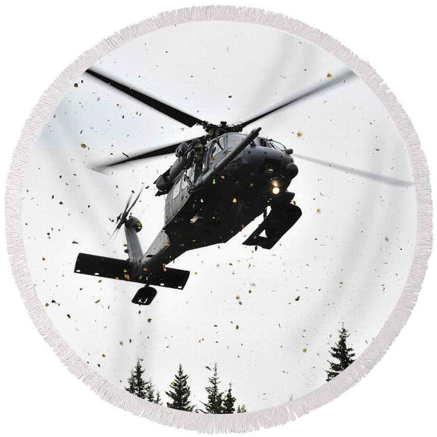 Infantry Round Beach Towel featuring the photograph An Hh-60g Pave Hawk Helicopter Prepares by Stocktrek Images